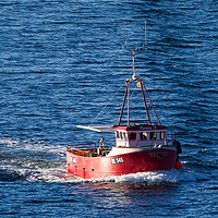 Buy canvas prints of Returning fishing boat by Tom Dolezal