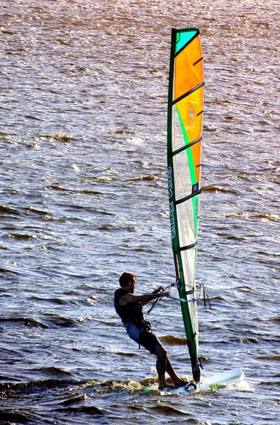 Wind-surfing in the afternoon           Canvas print by Peter Balfour