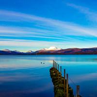 Buy canvas prints of Winter Sunset on Loch Lomond by Mark McGillivray