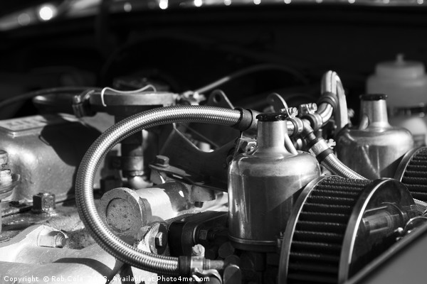 Twin SU Carburettors on a Classic Car Engine Canvas print by Rob Cole