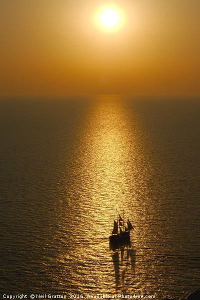 Sea Sunset from Oia Canvas print by Neil Gratton