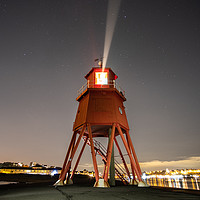 Buy canvas prints of The Herd Lighthouse at Night by Gary Clarricoates