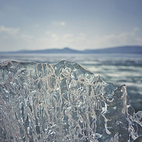Buy canvas prints of A piece of crystal transparent ice in the hand aga by Larisa Siverina