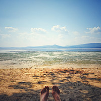 Buy canvas prints of foot lying on the beach by Larisa Siverina