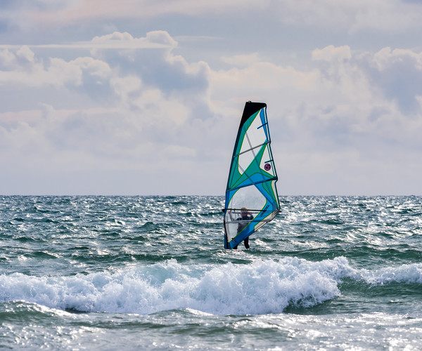 Windsurfing on Newgale Beach. Canvas print by Colin Allen
