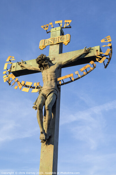 Crucifix Statue on the Charles Bridge in Prague Print by Chris Dorney