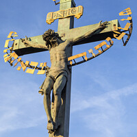 Buy canvas prints of Crucifix Statue on the Charles Bridge in Prague by Chris Dorney