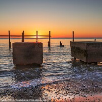 Buy canvas prints of Sunrise over the sea defences by Graeme Taplin