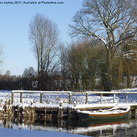 Buy canvas prints of  Snow on the Jetty River Wensum Norfolk by john hartley