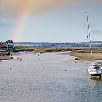 Buy canvas prints of Rainbow over Burnham Overy Staithe North Norfolk by john hartley