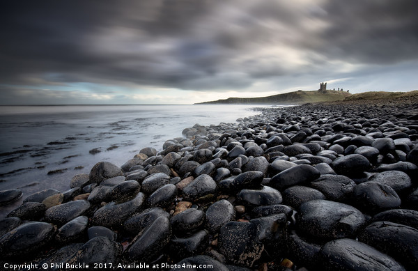 Dunstanburgh Boulders Canvas print by Phil Buckle