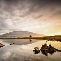 Buy canvas prints of Sunrise Reflections at Tewet Tarn by Phil Buckle