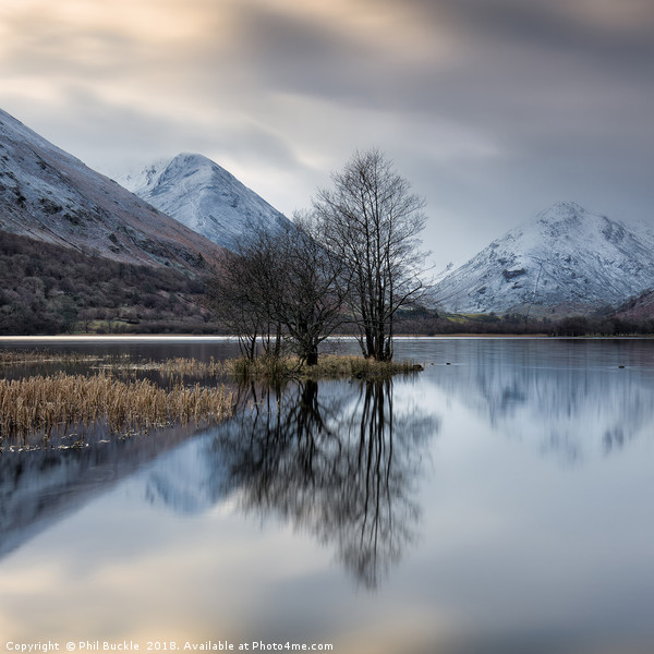 Brothers Water Winter Canvas print by Phil Buckle