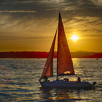 Buy canvas prints of Red Sailed yacht at Sunset by Paul Prestidge