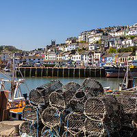 Buy canvas prints of Brixham Harbour with Crab Pots by Paul Prestidge