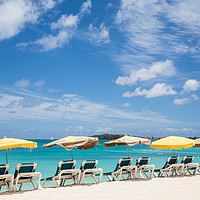 Buy canvas prints of Chaise Lounges Under Umbrellas on Beach by Darryl Brooks