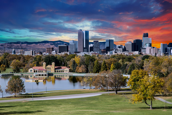 Denver Skyline and Mountains Beyond Lake Framed Mounted Print by Darryl Brooks