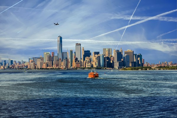 New York City with Ferries and Planes Framed Mounted Print by Darryl Brooks