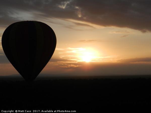Photo of an Air Balloon with the sun setting over  Canvas print by Matt Cass