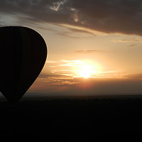 Buy canvas prints of Photo of an Air Balloon with the sun setting over  by Matt Cass