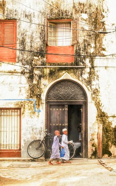 Kids walking Stonetown Zanzibar 3620 Tanzania East Framed Print by AMYN NASSER