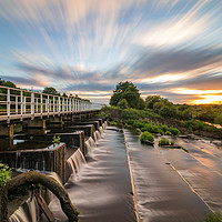 Buy canvas prints of Sunset explodes over the river Aire by Nigel Smith