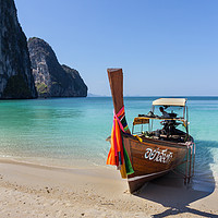 Buy canvas prints of Long tail boat on white sand beach by Kevin Hellon