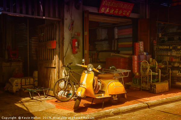 Yellow scooter Canvas Print by Kevin Hellon