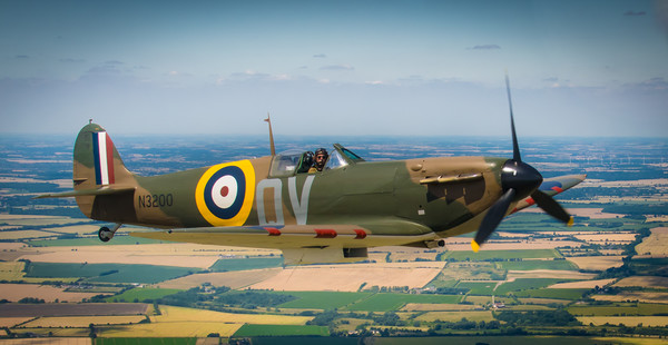 Spitfire MkI in flight Canvas print by Mike Lanning