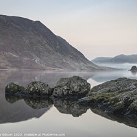 Buy canvas prints of Stunning Winter foggy sunrise on Crummock Water in Lake District England by Matthew Gibson