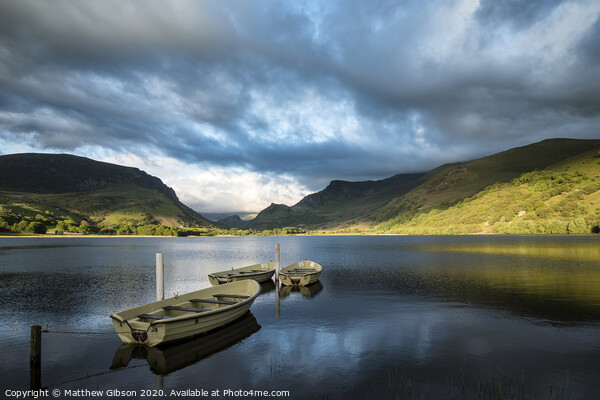Landscape image of rowing boats on Llyn Nantlle in Snowdonia at sunset Acrylic by Matthew Gibson