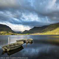 Buy canvas prints of Landscape image of rowing boats on Llyn Nantlle in Snowdonia at sunset by Matthew Gibson