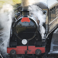 Buy canvas prints of Beautiful old vintage steam railway engine with full steam blowing by Matthew Gibson