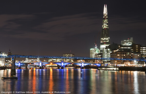 Beautiful landscape image of the London skyline at night looking along the River Thames Acrylic by Matthew Gibson