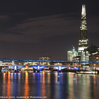 Buy canvas prints of Beautiful landscape image of the London skyline at night looking along the River Thames by Matthew Gibson