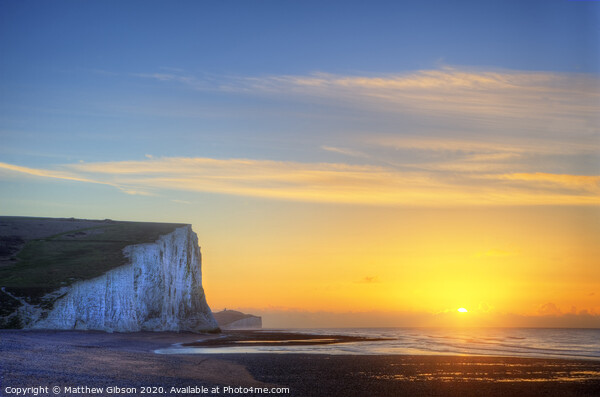 Stunning Winter landscape sunrise above the Seven Sisters cliffs Print by Matthew Gibson