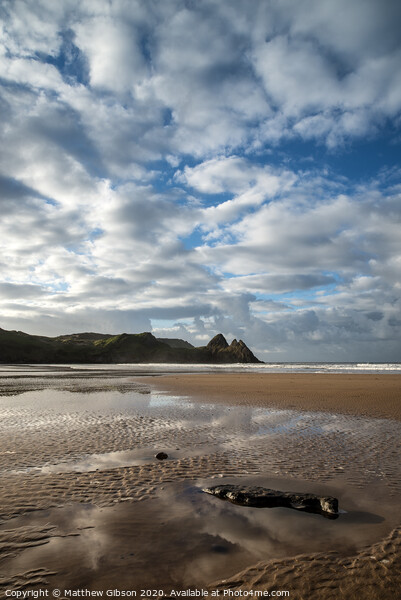 Beautiful blue sky morning landscape over sandy Three Cliffs Bay Framed Print by Matthew Gibson