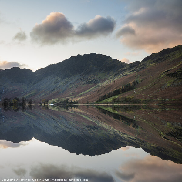 Majestic vibrant Autumn Fall landscape Buttermere in Lake District with beautiful early morning sunlight playing across the hills and mountains Print by Matthew Gibson