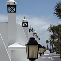 Buy canvas prints of Lamps and Chimneys by Catherine Evans