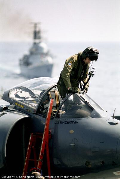 Pilot climbing onboard a Sea Harrier. Framed Print by Chris North