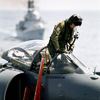 Buy canvas prints of Pilot climbing onboard a Sea Harrier. by Chris North