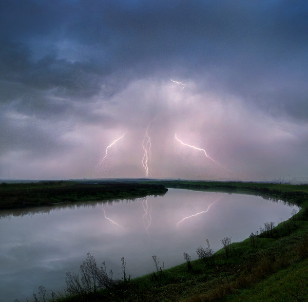 Kightning Strikes over the River Darent Canvas print by Adrian Campfield