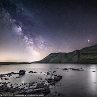 Buy canvas prints of The night sky above Llyn y Fan Fach by Karl McCarthy