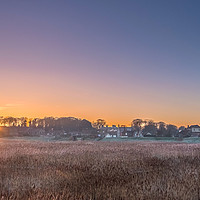 Buy canvas prints of Sun Rising through the Trees at Cley next the Sea by Jim Key