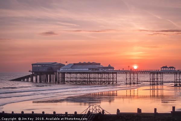 The Sun Rises above Cromer Pier Canvas print by Jim Key