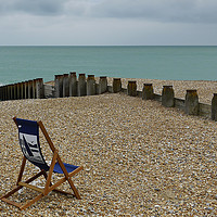 Buy canvas prints of The Lone Deck Chair by Dave Williams