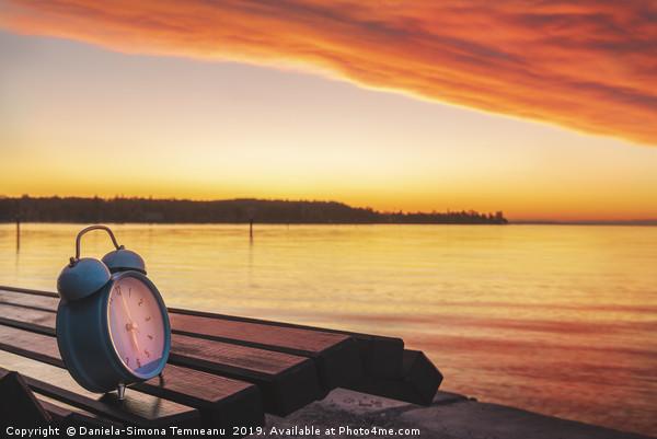 Alarm clock and sunrise over Lake Constance Canvas Print by Daniela-Simona Temneanu