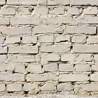 Buy canvas prints of Very old brick wall painted with light beige paint. by Sergii Petruk