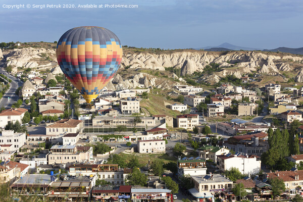 A balloon is flying over the valley in Cappadocia Print by Sergii Petruk