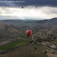 Buy canvas prints of A balloons is flying over the valley in Cappadocia by Sergii Petruk